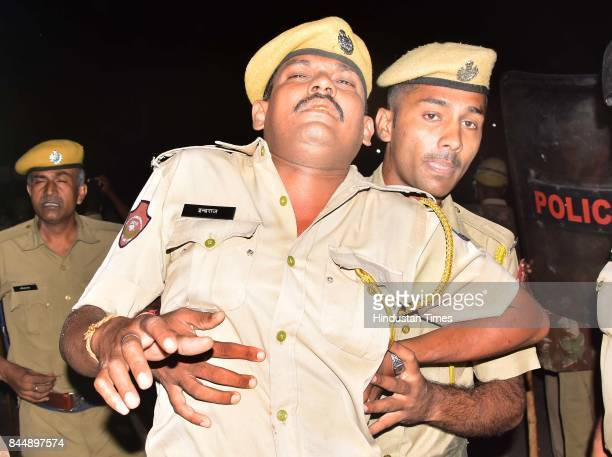 An injured official during clashes between police and the mob on late Friday night as curfew was imposed in parts of Jaipur after latenight violence...