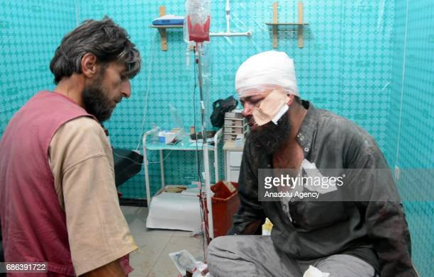 An injured opposition member receives treatment after a suicide attack against Ahrar alSham an armed opposition group that fights against Assad...