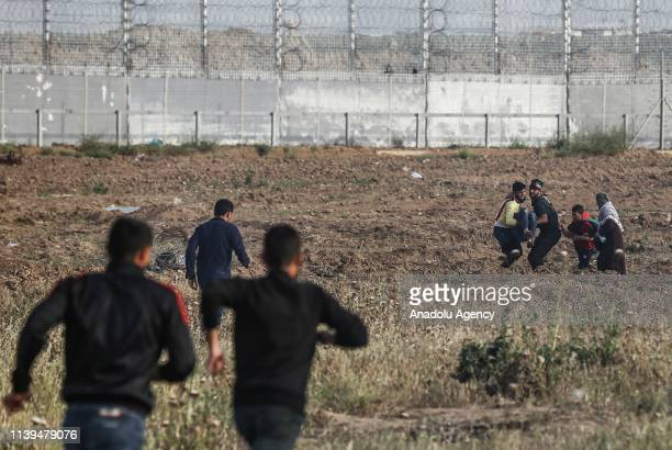 "An injured Palestinian is being carried away after Israeli forces interventions during a protest within the ""Great March of Return"" at Israel-Gaza..."