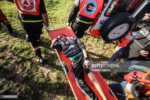 An injured Palestinian is being carried away during Israeli forces' intervention within a Great March of Return demonstration on Israeli Border of...