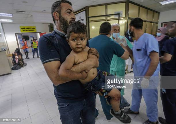 An injured Palestinian kid is being brought to Al-Shifa hospital to receive treatment after an Israeli air strike in Gaza City. In response to days...