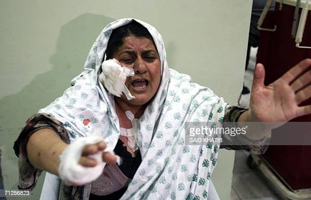 An injured Palestinian woman shouts at the Naser hospital in the southern Gaza Strip town of Khan Yunis 21 June 2006 following an Israeli air strike...