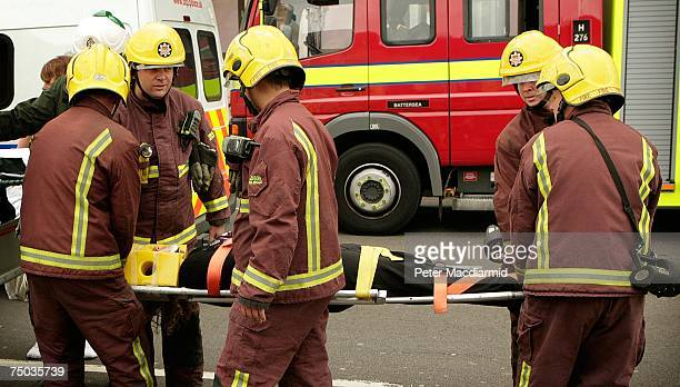 An injured passenger is carried by fire brigade officers after evacuation from Mile End station on July 5, 2007 in London. Up to six carraiges of a...