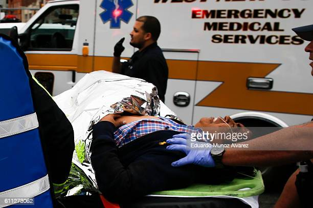 An injured passenger is taken from the scene after a New Jersey Transit train crashed into the platform at Hoboken Terminal during morning rush hour...