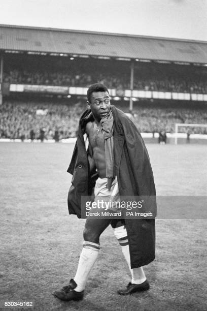 An injured Pele of Brazil trudges off as his side lose to Portugal 3-1 during the World Cup Tournament second round match at Goodsion Park, Everton...