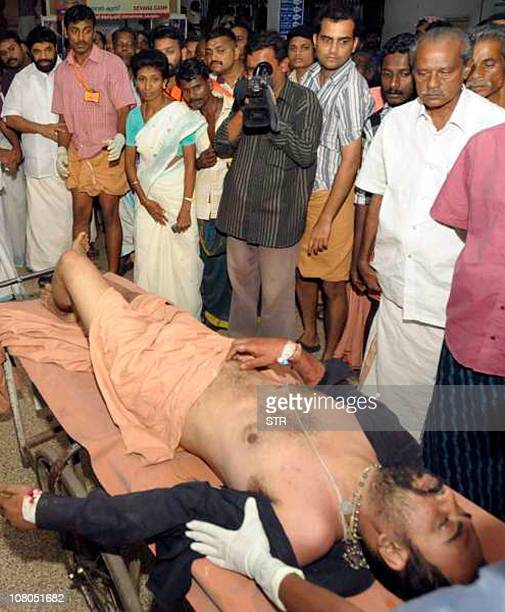 An injured pilgrim is rushed to a hospital after being rescued from a stampede in Pullumedu southern Indian state of Kerala on January 15 2011 More...