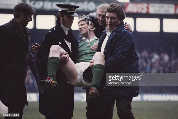 An injured player is carried off the pitch at a hurling match at Croke Park, Dublin, 17th March 1974.