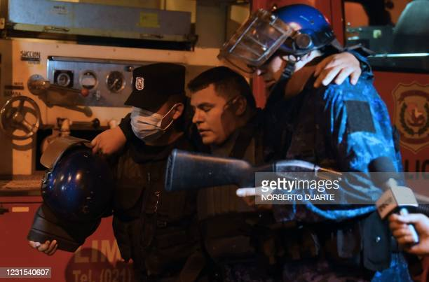 An injured policeman is helped by colleagues during confrontations with demonstrators following a protest against corruption and lacks in the health...