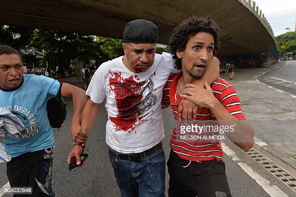 An injured protester is assisted during student demonstrations against the country's latest round of transport fare hikes in Sao Paulo Brazil on...