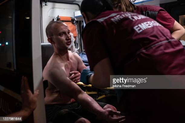 An injured protester is attended to by medical staff during a protest against Belarus President Alexander Lukashenko's claim of a landslide victory...