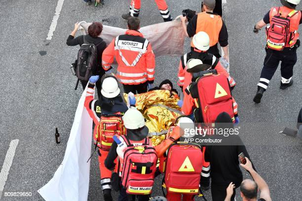 An injured protester is carried off for treatmeant during the 'Welcome to Hell' rally against the G20 summit in Hamburg northern Germany on July 6...