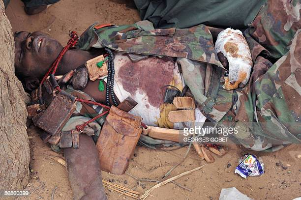 An injured rebel soldier lies on the ground on May 8 2009 in the area of Am Dam 130 km south of Abeché where fighting took place on May 7 between...
