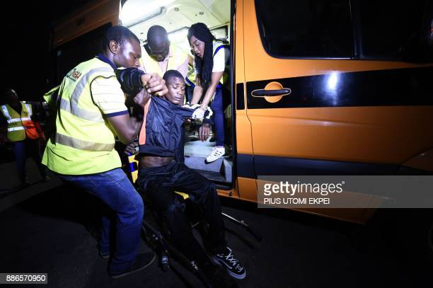 An injured returnee is being helped into an ambulance for medical attention after alighting from chartered aircraft that brought home 150 migrants...