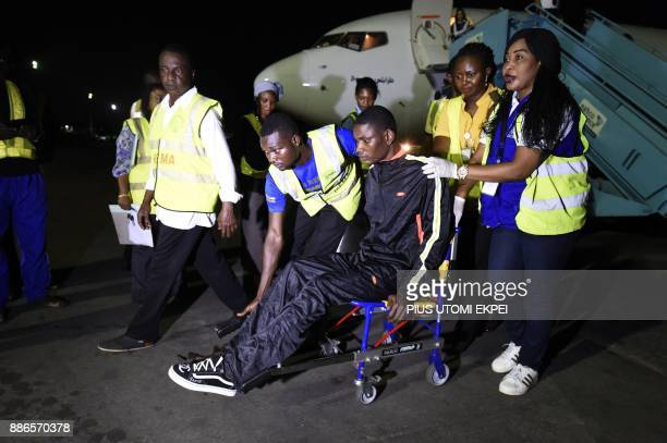 An injured returnee is being wheeled to an ambulance for medical attention after alighting from a chartered aircraft that brought home 150 migrants...