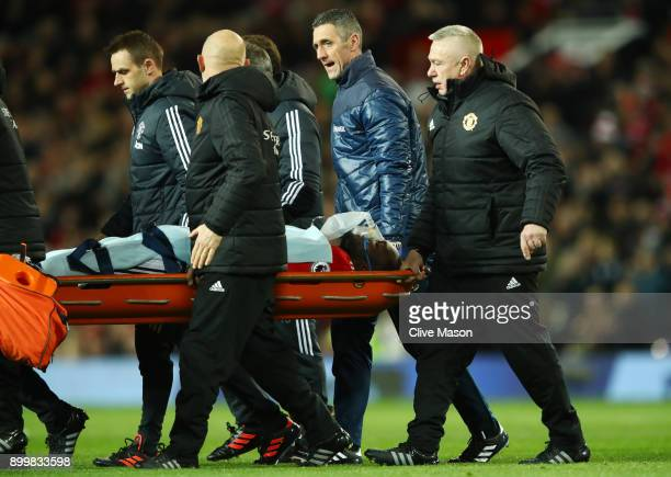 An injured Romelu Lukaku of Manchester United is strechered off during the Premier League match between Manchester United and Southampton at Old...
