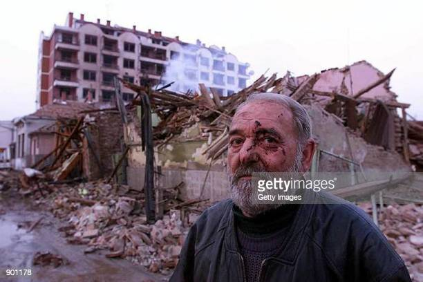 An injured Serb man in front of his destroyed house in the town of Aleksinac some 200 kilometers south of Belgrade Yugoslavia early Tuesday April 6...