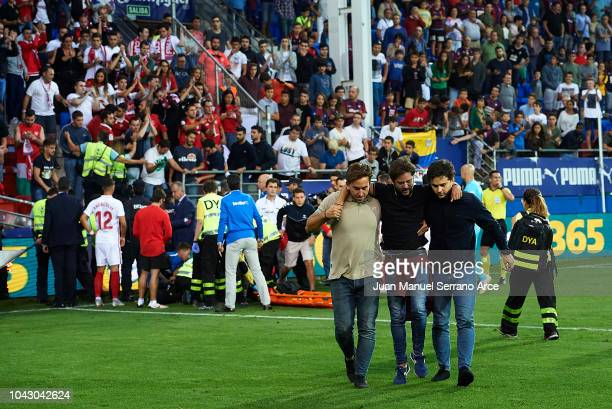 An injured Sevilla FC fan is carried away after a barrier collapsed during the la Liga match between SD Eibar and Sevilla FC at Ipurua Municipal...