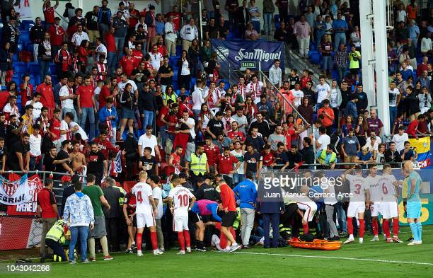 An injured Sevilla FC fan is seen to by medics after a barrier collapsed during the la Liga match between SD Eibar and Sevilla FC at Ipurua Municipal...
