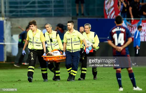 An injured Sevilla FC fan is stretched away for medical attention after a barrier collapsed during the la Liga match between SD Eibar and Sevilla FC...