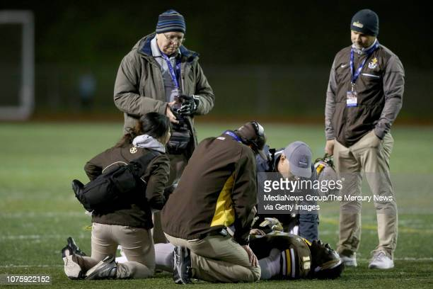 An injured St Francis' Maurice Wilmer is attended to in the fourth quarter of their Central Coast Section Open Division II championship football game...