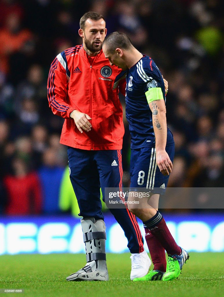 An injured Steven Fletcher (L) in discussion with captain Scott Brown of Scotland after the EURO 2016 Group D Qualifier match between Scotland and Republic of Ireland at Celtic Park on November 14, 2014 in Glasgow, Scotland.