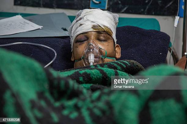An injured survivor lays on a bed inside the National Trauma Center on April 27, 2015 in Kathmandu, Nepal. A major 7.8 earthquake hit Kathmandu...