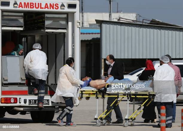 An injured Syrian man is being brought to Reyhanli State Hospital in Hatay Turkey on April 4 2017 Assad regime's suspected chlorine gas attack took...