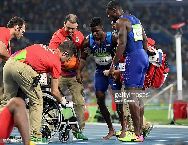 An injured Trayvon Bromell of the United States is assisted after falling at the finish of the Men's 4 x 100m Relay Final on Day 14 of the Rio 2016...
