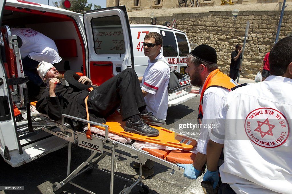 An injured Ultra-Orthodox Jewish man is evacuated by an ambulance during clashes with Israeli police over a protest against the removal of ancient tombs in Jaffa, just south of Tel Aviv, on June 16, 2010 where construction is due to take place at the site where religious men say Jewish graves are located.