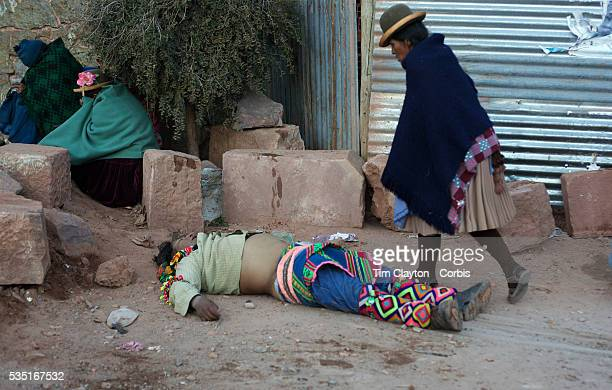 An injured villager lies unconscious after fighting in the streets of Macha during the Tinku Festival Macha Bolivia 4th May 2010 Photo Tim Clayton...