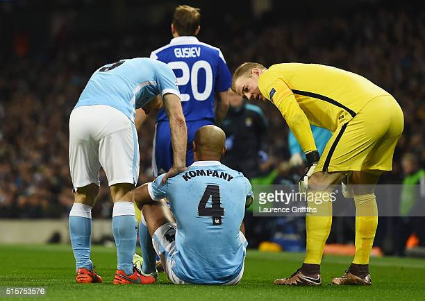 An injured Vincent Kompany of Manchester City in discussion with team mates Pablo Zabaleta and Joe Hart during the UEFA Champions League round of 16...