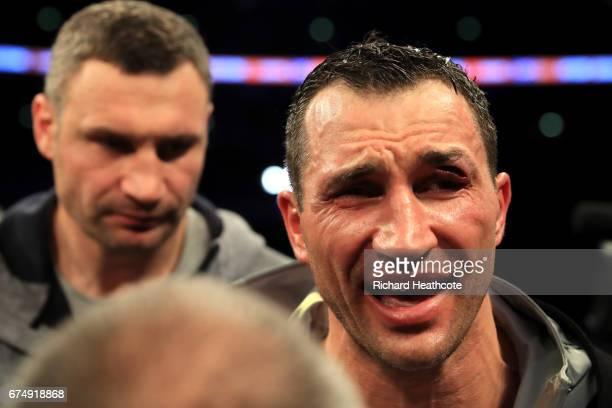 An injured Wladimir Klitschko looks on following defeat to Anthony Joshua the IBF WBA and IBO Heavyweight World Title bout at Wembley Stadium on...