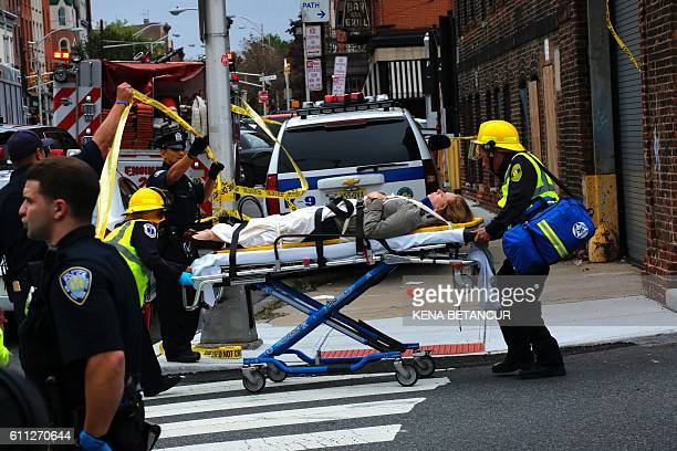 An injured woman is evacuated at New Jersey Transit's rail station in Hoboken New Jersey September 29 2016 A commuter train crashed into a station in...