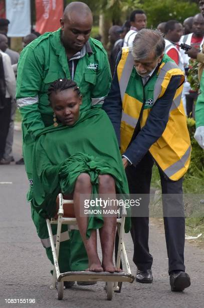 An injured woman is evacuated from the scene of an explosion at a hotel complex in Nairobi's Westlands suburb on January 15 in Kenya A huge blast...