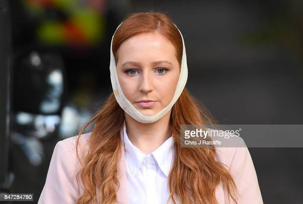 An injured woman makes her way from the scene at Parsons Green Underground Station on September 15 2017 in London England Several people have been...