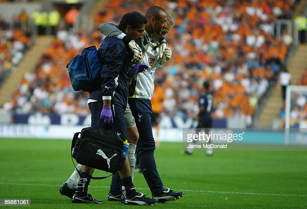 An injury to Heurelho Gomes of Tottenham Hotspur forces him to leave the pitch during the Barclays Premier League match between Hull City and...