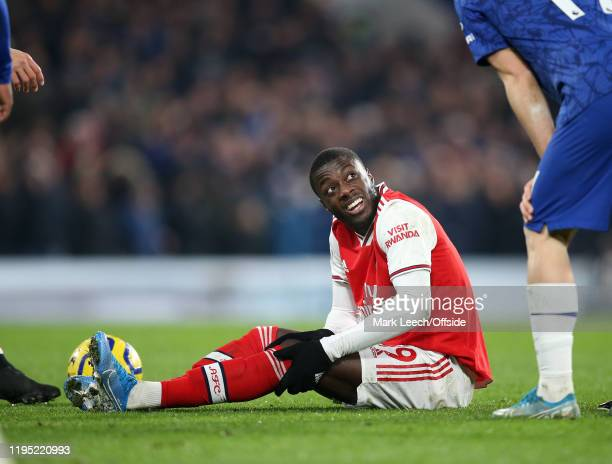 an injury to Nicolas Pepe of Arsenal during the Premier League match between Chelsea FC and Arsenal FC at Stamford Bridge on January 21 2020 in...