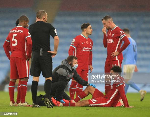 An injury to Trent Alexander-Arnold of Liverpool during the Premier League match between Manchester City and Liverpool at Etihad Stadium on November...
