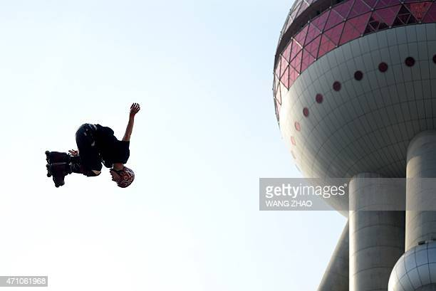 An inline skater performs during a demonstration event for the 2015 World Extreme Games in Shanghai on April 25 2015 This year's Extreme Games will...