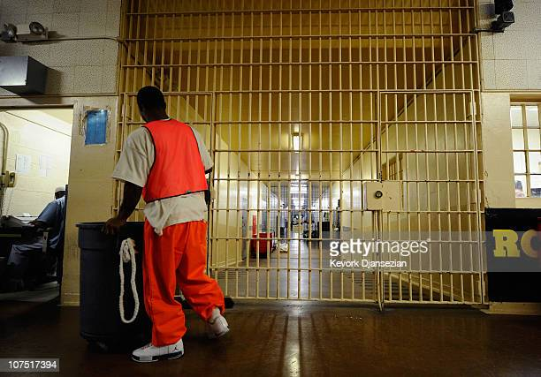 An inmate at Chino State Prison, which houses 5500 inmates, cleans the hallway on December 10, 2010 in Chino, California. The U.S. Supreme Court is...