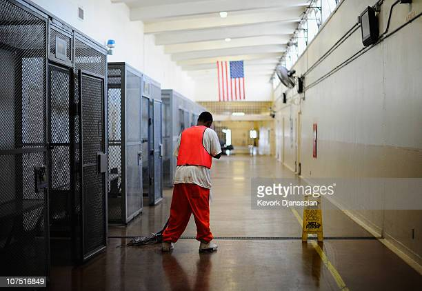 An inmate at Chino State Prison, which houses 5500 inmates, mops the hall way on December 10, 2010 in Chino, California. The U.S. Supreme Court is...