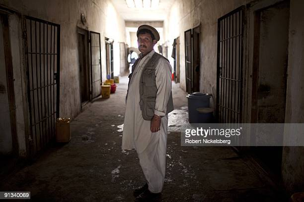 An inmate at the Ghazni provincial jail stands in the main holding cell wing during a visit by a team of US and Polish army officers in Ghazni...