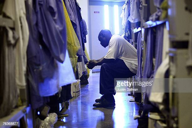 An inmate at the Mule Creek State Prison sits on his bunk bed in a gymnasium that was modified to house prisoners August 28 2007 in Ione California A...