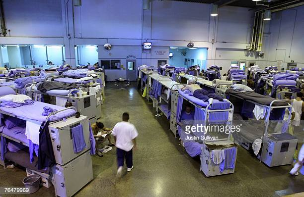 An inmate at the Mule Creek State Prison walks near their bunk beds in a gymnasium that was modified to house prisoners August 28 2007 in Ione...