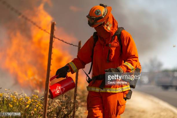 An inmate firefighter from Oak Glen Conservation Camp near Yucaipa California sets a backfire during the Easy Fire on October 30 2019 near Simi...