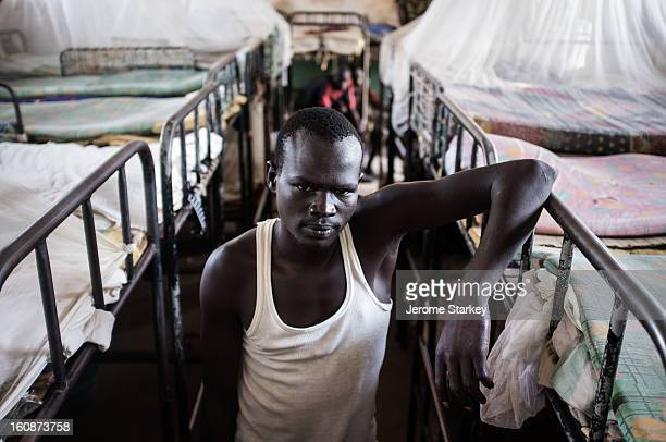 CONTENT] An inmate in Rumbek prison in South Sudan where around male prisoners live in four warehouselike dormitories crammed with bunk beds Oct 24...