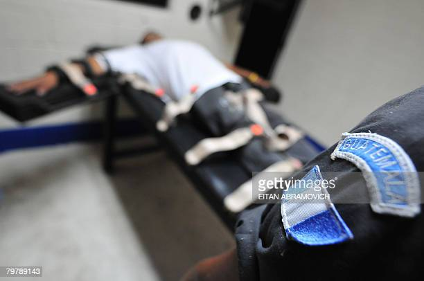 An inmate lays on a stretcher as he takes part in a simulation at the lethal unit's execution room at the Penitentiary Center of Pavon in Fraijanes...