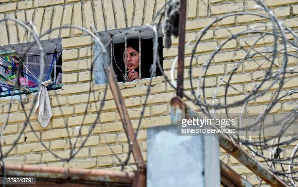 An inmate looks out the window of her cell at the Santa Monica women's prison in Lima on October 23, 2020. - After seven months without having any...