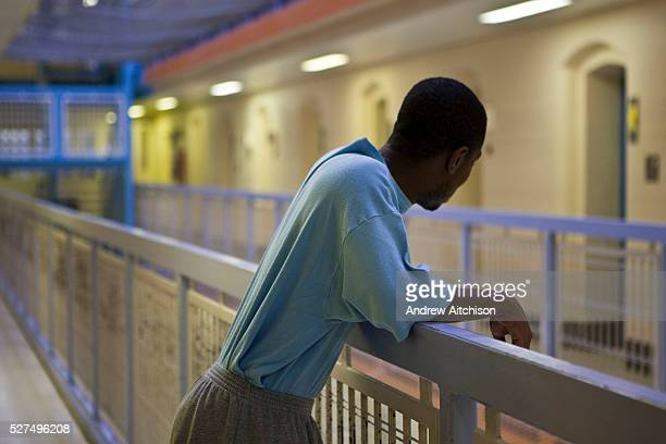 An inmate looks over D wing from the middle landing at HMP Wandsworth London UK Wandsworth is the largest prison in the UK currently able to hold...