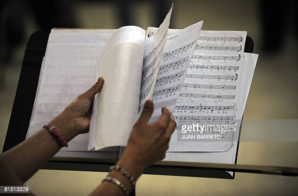 An inmate of the women's prison Instituto Nacional de Orientacion Femenina arranges a score during music lessons inside the prison on June 10 in the...